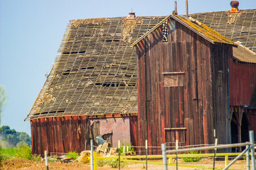 Old Abandoned Wooden Barn With See Through Roof