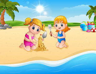 Two girl making sand castle with shovel