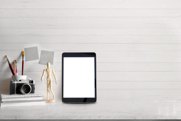 Mock up Blank screen tablet and modern home decor with camera, dummy. Artist workspace with copy space for products display montage..