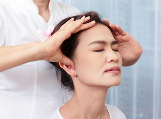 Close up of Thai massage face stretching, Spa Concept