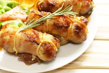 Roast rolls of chicken fillet with herbs