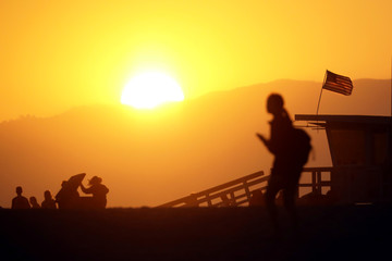 People on the beach at sunset in Santa Monica, California