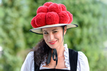 Attractive woman wearing a traditional Bollenhut