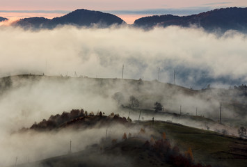 fog above the rural hills at dawn