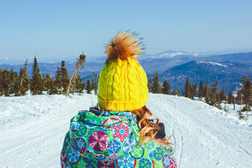 Girl in the winter in the mountains