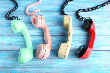Telephone handsets on blue wooden table