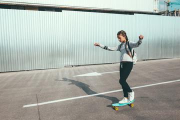 Pre teen skater on the city street
