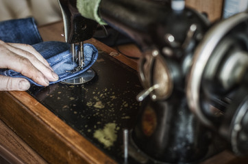 close-up hand and sewing machine