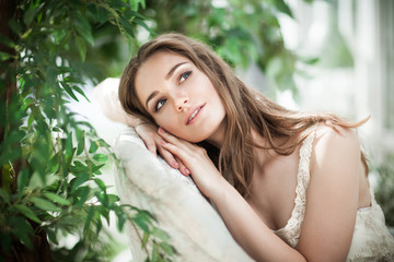 Beautiful Woman Fashion Model Dreaming in Green Leaves