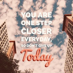 """Inspirational motivational quote """"you are one step closer everyday, so don't give up today"""" on buildings and sky background."""