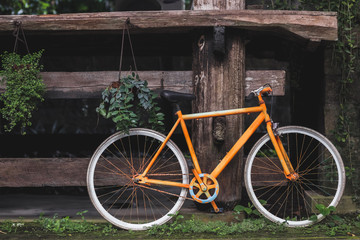 Old fixie bicycle as decoration of hotel in village rustic style in Bali tropical nature