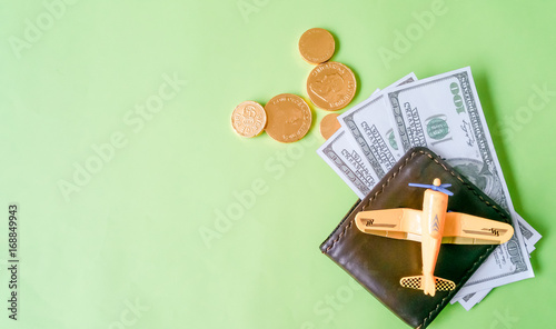 Model aircraft symbol and pocket money on table desktop Mix for
