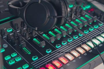Headphone and sound mixer close up. Music