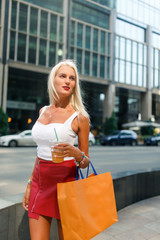 Photo of blonde with packages