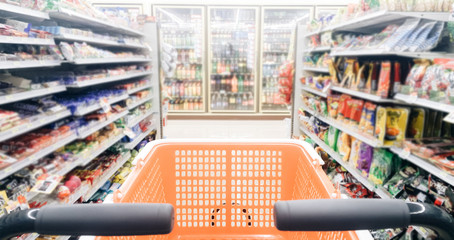 Blurred photo of store with empty shopping Cart or trolley in Supermarket store .