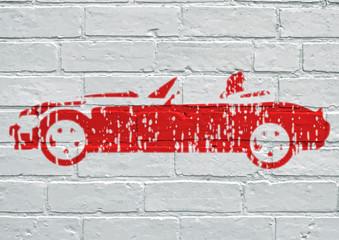 Street art. Voiture de sport rouge décapotable