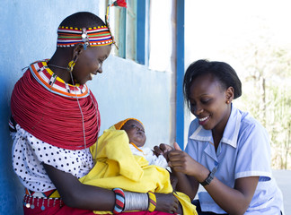 Nurse examing Mother and Baby in clinic. Kenya, Africa