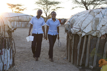 Two nurses working in rural village location. Kenya, Africa.