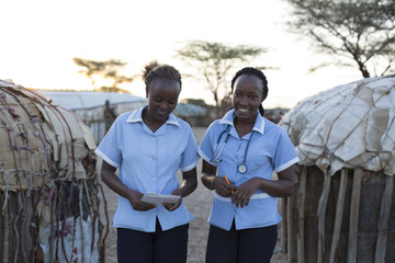 Two Nurses working on location in rural village. Kenya, Africa.