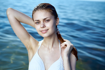 Beautiful young woman is resting on the sea, ocean, beach, sun, summer