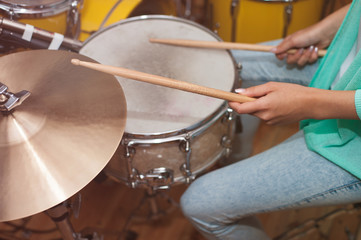 Woman playing the drums, studio recording/rehearsal time