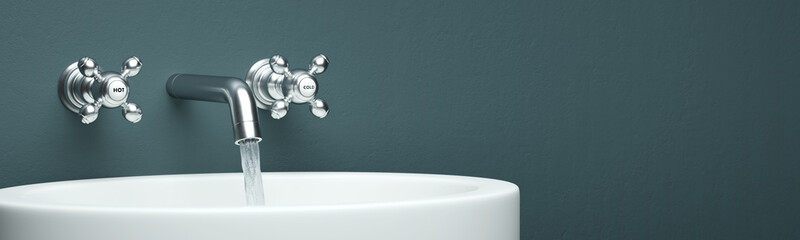 Modern faucet as panorama with green wall