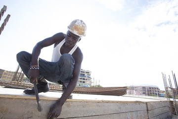 Man working on construction site. Kenya, Africa.