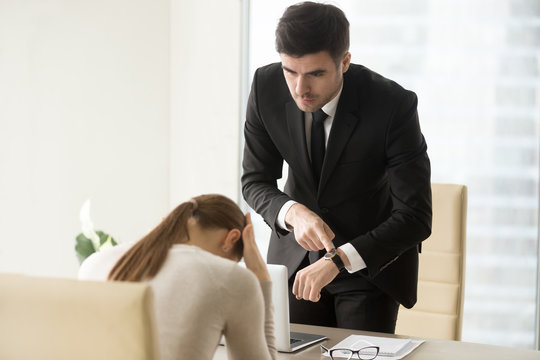 Upset woman being scolded by boss for coming late at office, frustrated manager feeling guilty because of missed deadline while receiving reprimand, ceo scolding unpunctual employee after bad work