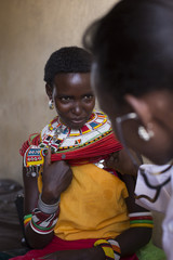 Female Doctor examining female Samburu patient. Kenya, Africa