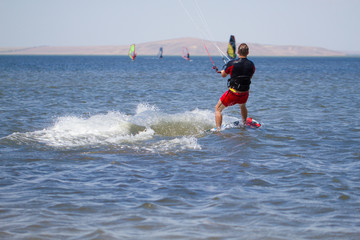 Man is engaged in kitesurfing