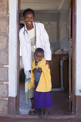 Doctor with young Maasai child, at clinic. Kenya, Africa.