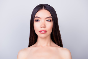 Beauty and health concept. Young pretty asian lady with healthy skin, hair, looking straight in the camera. So fresh, attractive and healthy