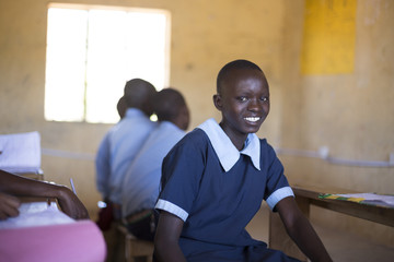 Portrait of school girl in classroom. Kenya, Africa.