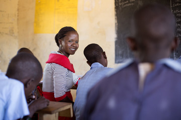 Female teacher, teaching school children. kenya, Africa.