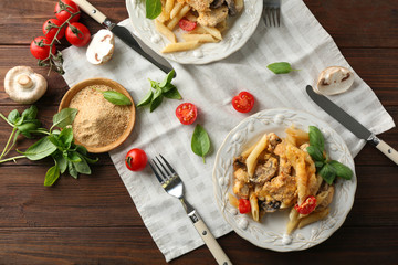 Plate with delicious turkey tetrazzini on table