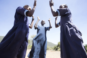 Teenage school girls playing outdoors. Kenya.