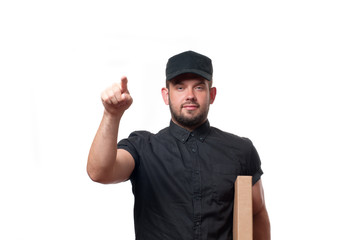 Delivery man with cardboard box is ringing the door bell