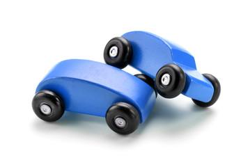 Blue toy car crash against white background