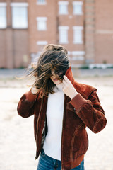 A gust of wind ruffled her hair