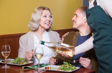 Mature couple spending time in restaurant