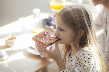 Cute Girl Eating Toast With Jam