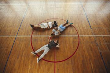 Basketball Players Lying on Court