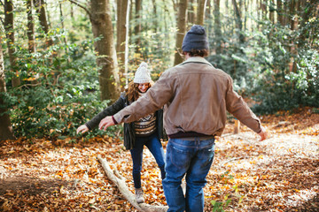 Couple in love enjoying an autumn day on the woods.