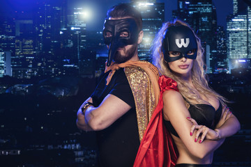Super hero couple over city