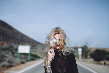 beautiful blonde woman with a magnifying glass