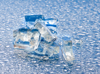 Image of pieces of ice and drops of water close-up