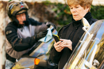 Rider: Woman Planning Ride On Cell Phone