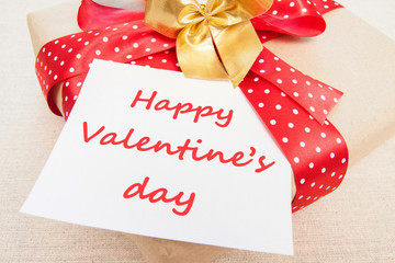 Blank, Valentine, greeting card with gift box, knitting loving couple, red ribbon Handmade concept.  Happy valentine's day.
