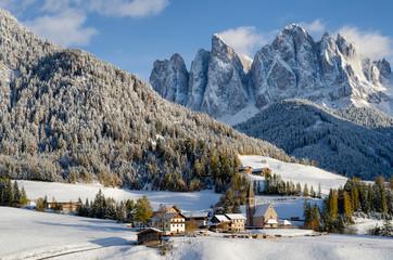 Dolomites village in the snow in winter