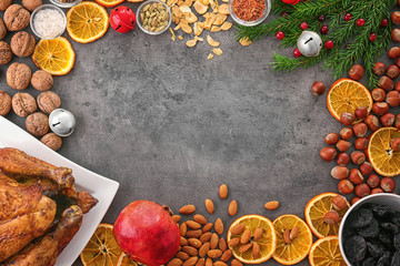 Composition with whole roasted turkey and some products on grey background